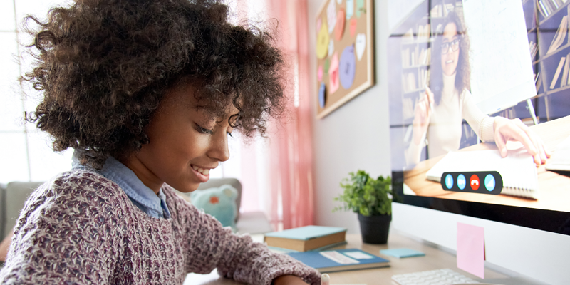 Young-girl-receiving-online-tuition-at-home
